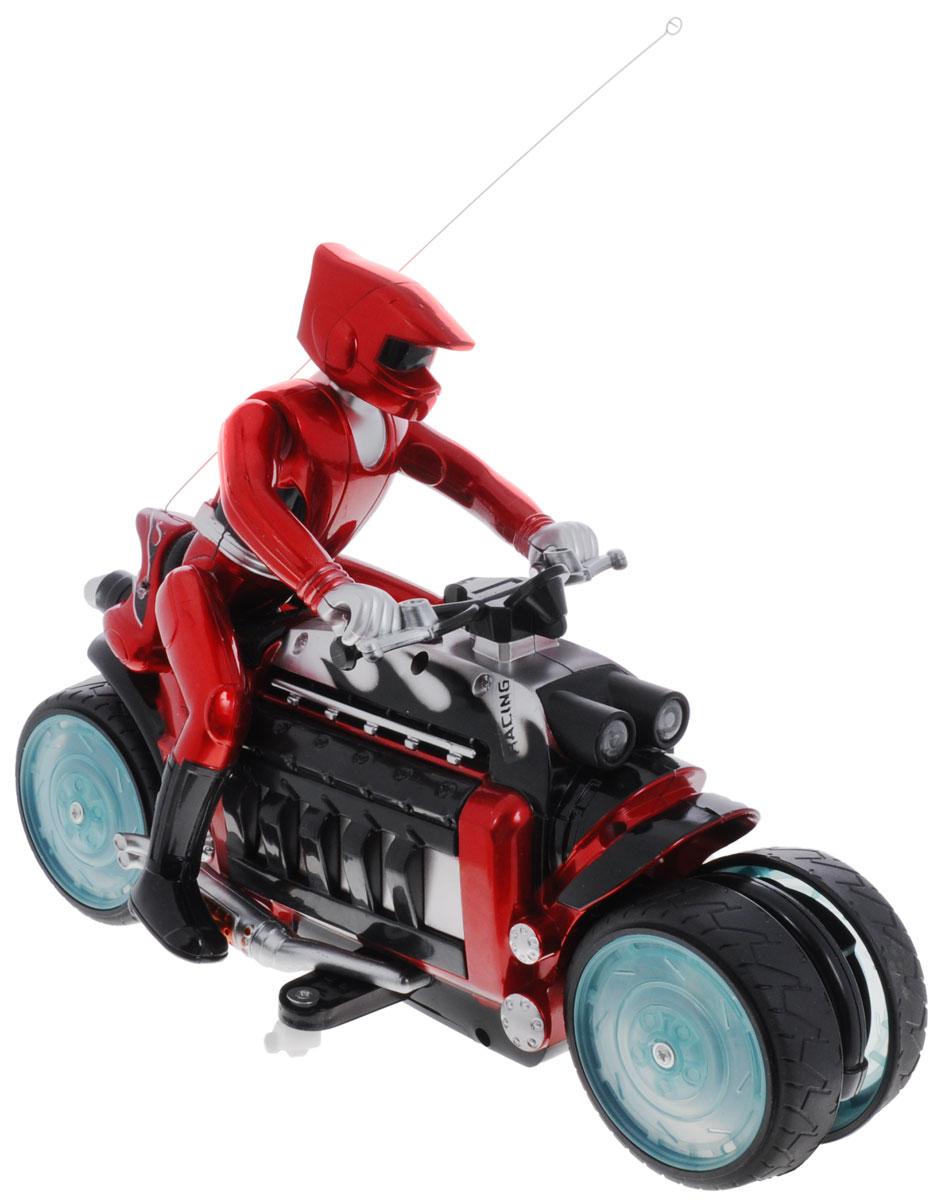 """Мотоцикл на радиоуправлении """"Moto-Drift"""" несомненно понравится любому мальчишке. Детализированный корпус модели изготовлен из пластика, колесики прорезинены, что обеспечивает надежное сцепление с любой гладкой поверхностью. Пульт управления позволяет мотоциклу двигаться, вперед, назад, влево и вправо, а съемная фигурка мотоциклиста наклоняется и поворачивается в соответствии с направлением движения. Мотоцикл может выполнять захватывающие трюки, такие как дрифт по кругу и езда боком. Колёса его ярко светятся разными цветами, и вы слышите мощный рёв мотора. Также во время движения вы можете включить музыку, выбрав одну из трёх композиций. Ваш ребенок часами будет играть с моделью, придумывая различные истории и устраивая соревнования. Порадуйте его таким замечательным подарком! Для работы мотоцикла необходим аккумулятор (входит в комплект). Для работы пульта управления необходима 1 батарейка типа """"Крона (входит в комплект)."""