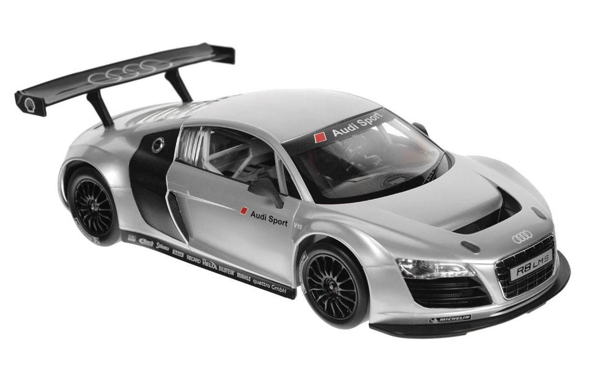 """Радиоуправляемая модель """"Audi R8 LMS"""" со световыми эффектами, являющаяся точной копией настоящего автомобиля, - отличный подарок не только ребенку, но и взрослому. Автомобиль с литым корпусом изготовлен из современных прочных материалов и обладает высокой стабильностью движения, что позволяет полностью контролировать его процесс, управляя без суеты и страха сломать игрушку. Основные направления движения автомобиля: вперед-назад-влево- вправо. Движение вперед и назад сопровождается сигнальными световыми эффектами фар. В комплект входят автомобиль, пульт управления и инструкция на русском языке.Автомобиль работает от 5 батареек типа АА, пульт управления - от батарейки 9V 6F22 (не входит в комплект)."""