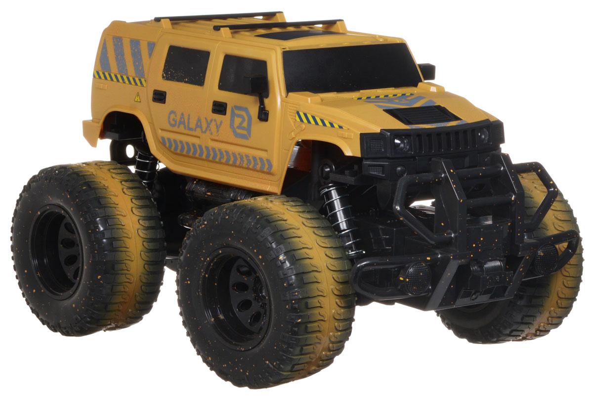 """Машина на радиоуправлении Balbi """"Galaxy"""" станет отличным подарком любому мальчишке! Мощный внедорожник на огромных колесах с настоящими пружинными амортизаторами и внушительным пластиковым бампером не оставит равнодушными ни детей, ни взрослых. Модель выполнена из прочного безопасного пластика в масштабе 1/10 к реальному прототипу. Благодаря выдающимся характеристикам ходовой части играть с машиной можно на улице, при этом она будет легко преодолевать значительные препятствия. Машинка движется вперед, назад, вправо, влево и останавливается. Фары машины при движении светятся. Пульт управления работает на частоте 27 MHz. Машина работает от сменного аккумулятора (входит в комплект). Для работы пульта управления необходимо докупить 2 батарейки напряжением 1,5V типа АА (не входят в комплект)."""