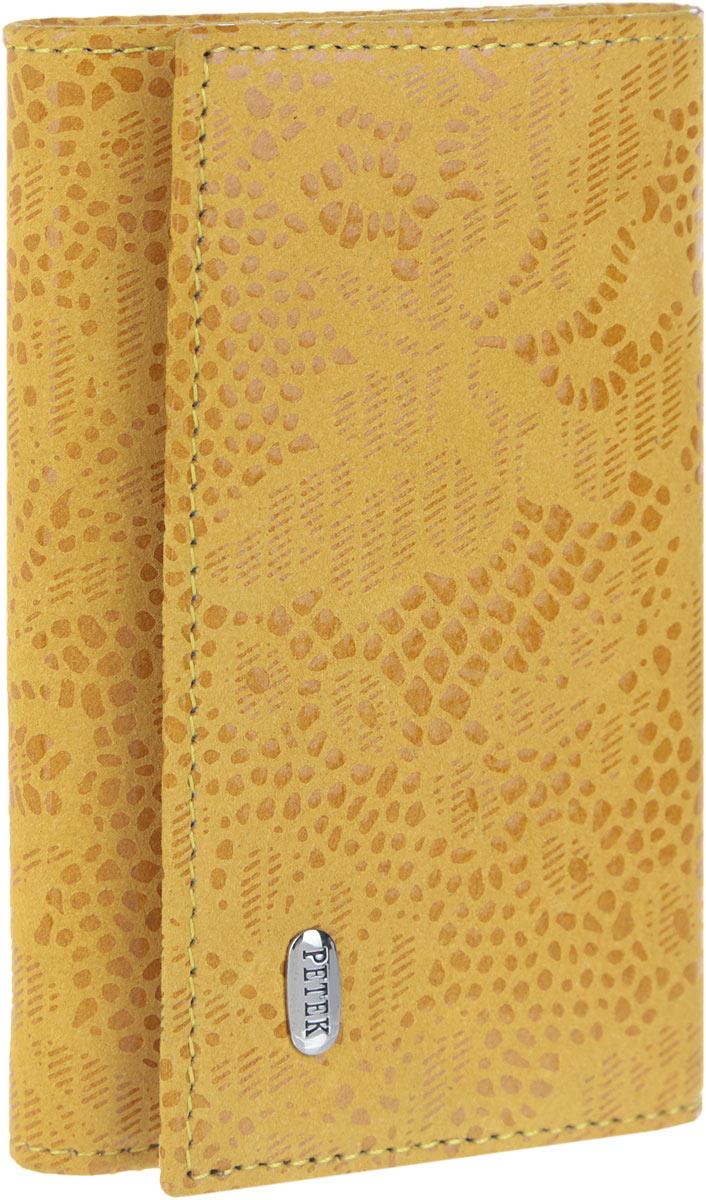 Ключница женская Petek 1855, цвет: желтый. 509.109.14Брошь-булавкаСтильная женская ключница Petek 1855 выполнена из натуральной кожи с лазерной обработкой и цветочным принтом и оформлена металлической пластиной с гравировкой бренда. Изделие закрывается на клапан с кнопкой. Внутри находится шесть металлических крючков для ключей, отделение для купюр, прорезной карман на застежке-молнии и карман с сетчатым окошечком. Ключница упакована в фирменную коробку.Этот аксессуар станет замечательным подарком человеку, ценящему качественные и практичные вещи.