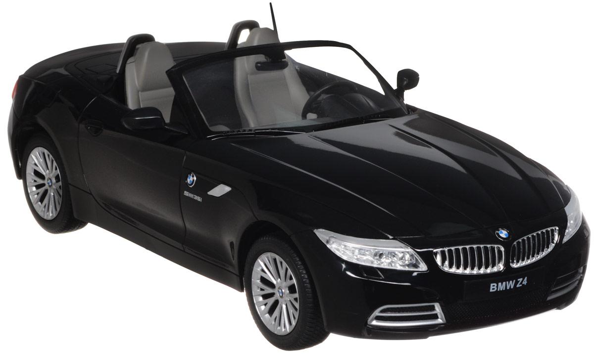 """Радиоуправляемая модель Rastar """"BMW Z4"""" обязательно привлечет внимание взрослого и ребенка и понравится любому, кто увлекается автомобилями. Все дети хотят иметь в наборе своих игрушек ослепительные, невероятные и крутые автомобили на радиоуправлении. Тем более если это автомобиль известной марки с проработкой всех деталей, удивляющий приятным качеством и видом. Маневренная и реалистичная уменьшенная копия """"BMW Z4"""" выполнена в точной детализации с настоящим автомобилем в масштабе 1:12. Управление машинкой происходит с помощью удобного пульта. Автомобиль двигается вперед и назад, поворачивает направо и налево. Автомобиль изготовлен из пластика с металлическими элементами. Колеса игрушки прорезинены и обеспечивают плавный ход, машинка не портит напольное покрытие. Радиоуправляемые игрушки способствуют развитию координации движений, моторики и ловкости. Ваш ребенок часами будет играть с моделью, придумывая различные истории и устраивая соревнования. Порадуйте его..."""