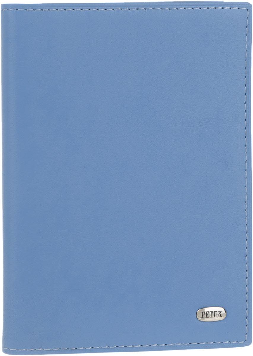Обложка для автодокументов женская Petek 1855, цвет: голубой. 584.167.74584.167.74 Violet BlueСтильная женская обложка для автодокументов Petek 1855 выполнена из натуральной кожи. Изделие оформлено металлической пластиной с гравировкой бренда. Внутри имеется два боковых кармана, блок из шести прозрачных файлов из мягкого пластика, один из которых формата А5 и четыре прорезных кармана для визиток и пластиковых карт.Такая обложка не только поможет сохранить внешний вид ваших документов и защитит их от повреждений, но и станет стильным аксессуаром, идеально подходящим вашему образу.