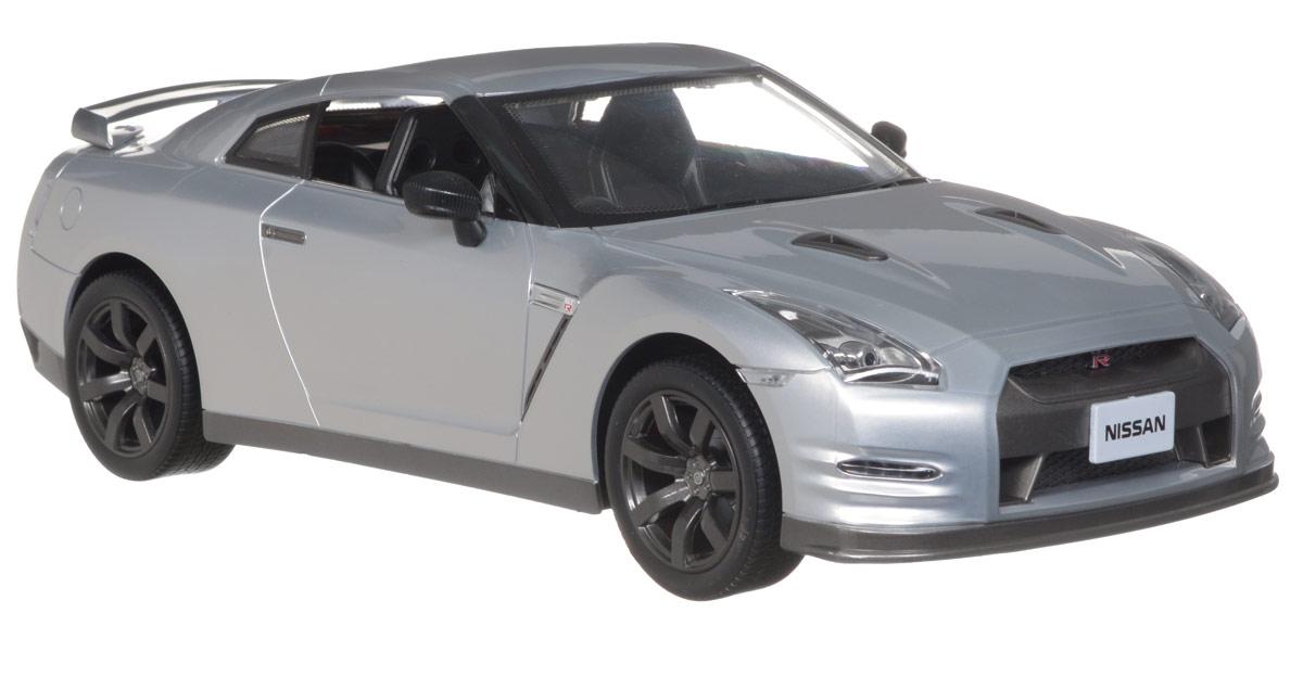 """Радиоуправляемая модель """"Nissan GT-R"""" стильного серебристого цвета является точной уменьшенной копией настоящего автомобиля в масштабе 1:12. Модель привлечет внимание не только ребенка, но и взрослого. Машинка при помощи пульта управления движется вперед, дает задний ход, поворачивает влево и вправо, останавливается. Фары машины светятся. Модель обладает высокой стабильностью движения, что позволяет полностью контролировать его процесс, управляя уверенно и без суеты. Такая модель станет отличным подарком не только любителю автомобилей, но и человеку, ценящему оригинальность и изысканность, а качество исполнения представит такой подарок в самом лучшем свете. Машина работает от 5 батарей типа АА (не входят в комплект), пульт управления работает от батареи напряжением 9V (не входит в комплект)."""