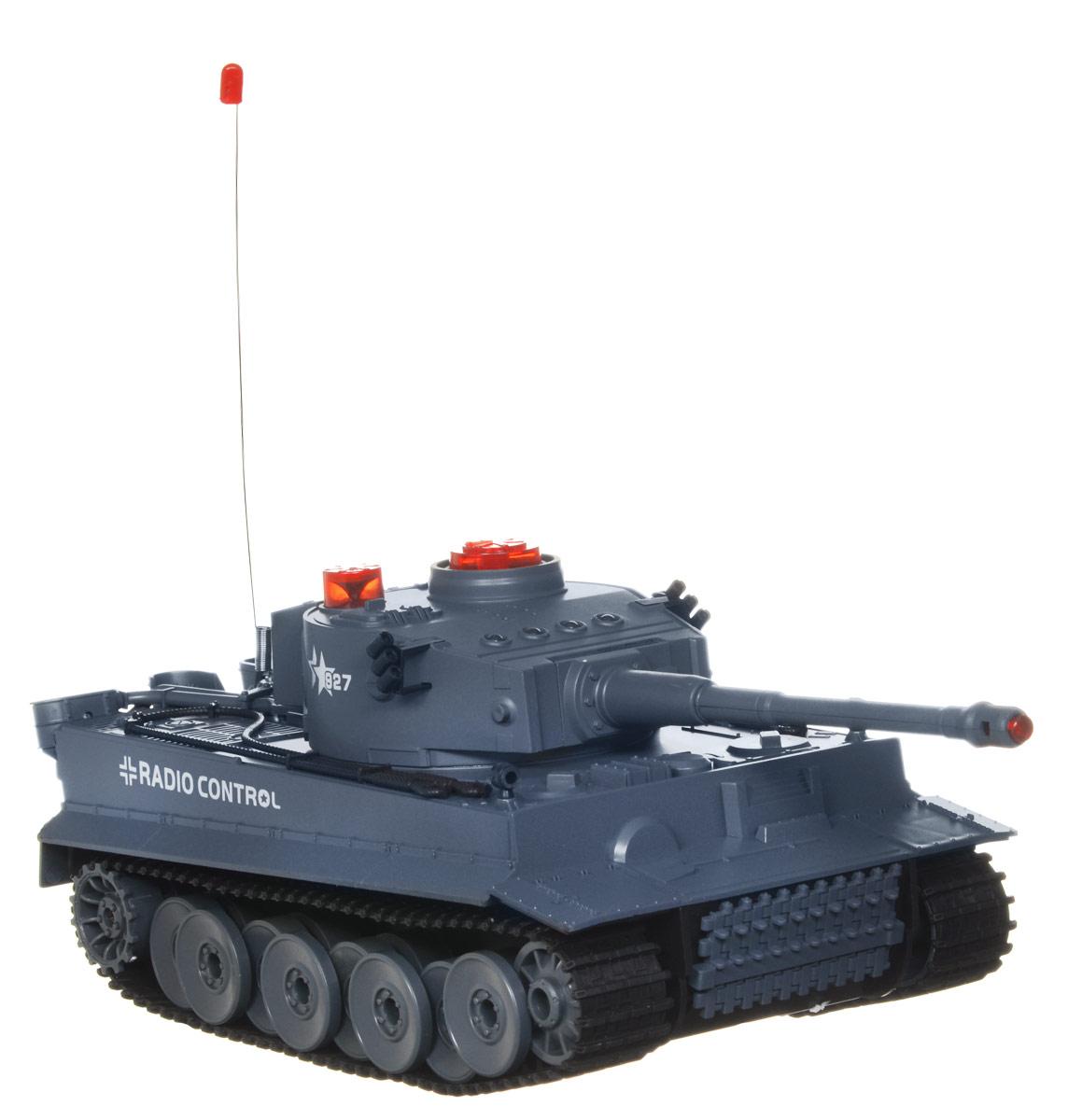 """Радиоуправляемый """"Боевой танк"""" понравится не только малышам, но и взрослым любителям военной техники. Игрушка выполнена из безопасного прочного пластика с элементами из металла и дополнена системой инфракрасного наведения. Танк может двигаться вправо, влево, вперед и назад, вращаться на месте. Башня танка может вращаться направо и налево на 180 градусов, а регулируемая пушка опускается и поднимается. Вверху танка имеются индикаторы жизни и питания. Радиус действия пульта управления составляет 10 метров, радиус инфракрасных выстрелов - 3 метра. Реалистичные световые и звуковые эффекты при стрельбе позволяют еще глубже окунуться в атмосферу настоящего танкового боя. Радиоуправляемые игрушки развивают многочисленные способности ребенка: мелкую моторику, пространственное мышление, реакцию и логику. Порадуйте своего ребенка таким замечательным подарком! Игрушка работает от съемного аккумулятора напряжением 7,2V с зарядным устройством (входят в комплект). ..."""
