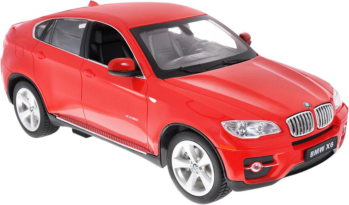 """Радиоуправляемая модель Rastar """"BMW X6"""" станет отличным подарком любому мальчику! Все дети хотят иметь в наборе своих игрушек ослепительные, невероятные и модные автомобили на радиоуправлении. Тем более, если это автомобиль известной марки с проработкой всех деталей, удивляющий приятным качеством и видом. Одной из таких моделей является автомобиль на радиоуправлении Rastar """"BMW X6"""". Это точная копия настоящего авто в масштабе 1:14. Авто обладает неповторимым провокационным стилем и спортивным характером. Потрясающая маневренность, динамика и покладистость - отличительные качества этой модели. Возможные движения: вперед, назад, вправо, влево, остановка. При движении загораются фары и стоп-сигналы. Машина работает от 5 батареек типа АА напряжением 1,5V, пульт работает от батарейки 9V типа """"Крона"""" (не входят в комплект)."""