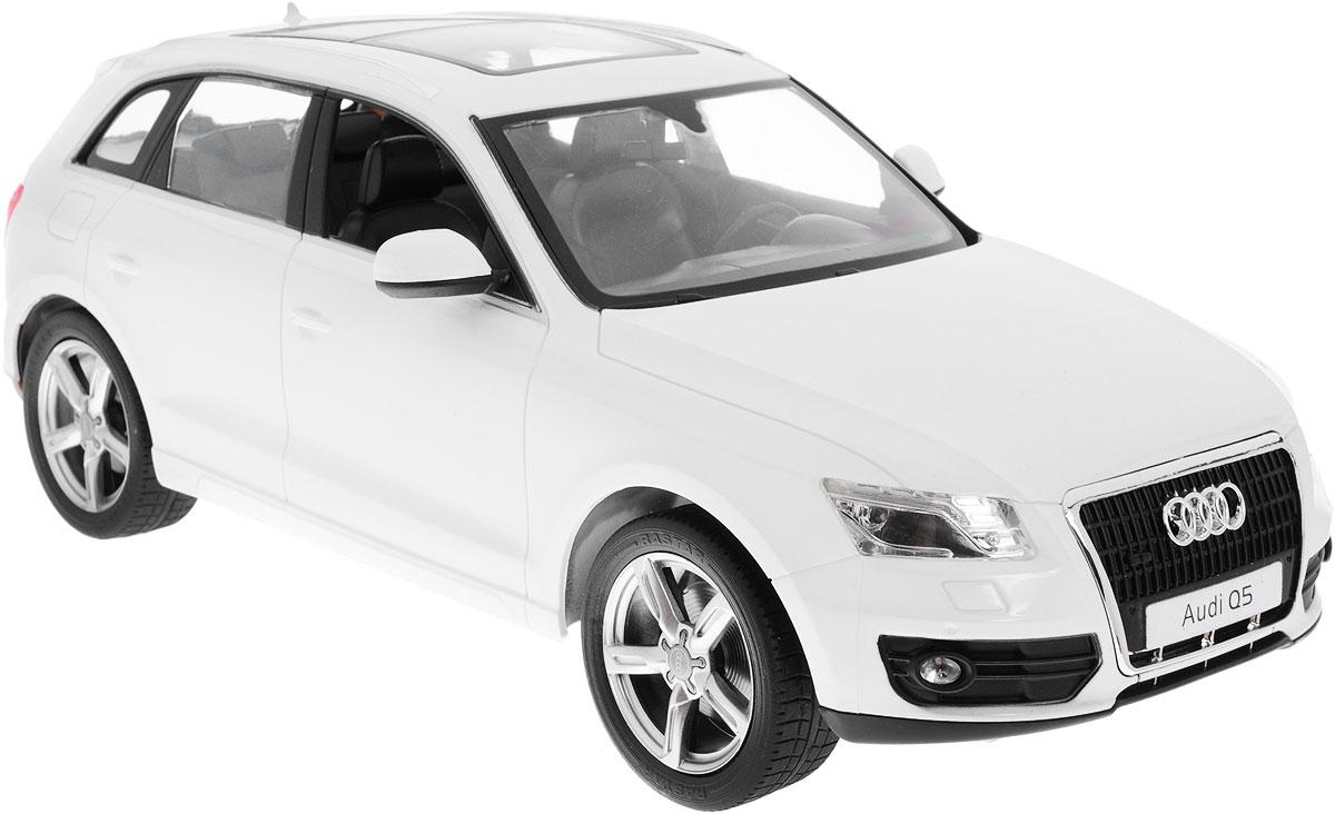 """Радиоуправляемая модель Rastar """"Audi Q5"""" станет отличным подарком любому мальчику! Все дети хотят иметь в наборе своих игрушек ослепительные, невероятные и модные автомобили на радиоуправлении. Тем более, если это автомобиль известной марки с проработкой всех деталей, удивляющий приятным качеством и видом. Одной из таких моделей является автомобиль на радиоуправлении Rastar """"Audi Q5"""". Это точная копия настоящего авто в масштабе 1:14. Авто обладает неповторимым провокационным стилем и спортивным характером. Потрясающая маневренность, динамика и покладистость - отличительные качества этой модели. Возможные движения: вперед, назад, вправо, влево, остановка. При движении загораются фары и стоп-сигналы. Машина работает от 5 батареек типа АА напряжением 1,5V, пульт работает от батарейки 9V типа """"Крона"""" (не входят в комплект)."""