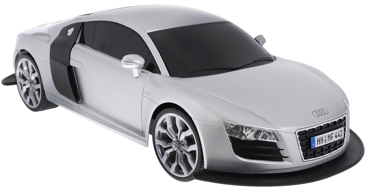 """Радиоуправляемая модель """"Audi R8 V10"""" яркого красного цвета является точной уменьшенной копией настоящего автомобиля. Модель выполнена из прочных материалов и украшена передним и задним обвесами, шины выполнены из резины. Машинка при помощи пульта управления движется вперед, дает задний ход, поворачивает влево и вправо, останавливается. С помощью пульта управления также можно контролировать свет передних и задних фар (выключение, ближний свет, дальний свет). Машина развивает хорошую скорость и обладает высокой стабильностью движения, что позволяет полностью контролировать процесс, управляя уверенно и без суеты. Пульт управления имеет три частоты, что позволяет одновременно управлять 2-3 моделями. Такая машинка станет отличным подарком не только любителю автомобилей, но и человеку, ценящему оригинальность и изысканность, а качество исполнения представит такой подарок в самом лучшем свете. Машина работает от аккумулятора 7,2V (входит в комплект),..."""