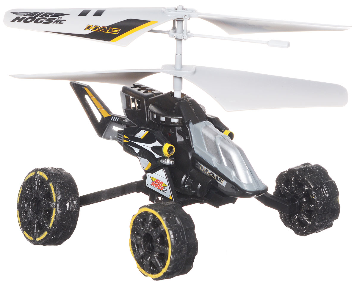 """Машина-вертолет на инфракрасном управлении AirHogs """"Hover Assault Eject"""" станет отличным подарком любому мальчишке! Машина-вертолет - очередное чудо техники от AirHogs. Этот уникальный вертолет может легко трансформироваться в машину с большими колесами, путем присоединения колесной базы. За счет вращения винтов она может двигаться либо по земле (вперед, влево, вправо), либо летать, как настоящий вертолет. Кроме того, при нажатии кнопки на пульте стреляет ракетами, находясь на земле или в воздухе. К игрушке прилагаются 6 патронов - вертолет может стрелять по мишеням! Управление вертолетом осуществляется с помощью 3-канального инфракрасного пульта управления. Встроенный гироскоп обеспечит ровность полета. Игрушка работает от встроенного аккумулятора. Для работы пульта управления необходимы 6 батареек напряжением 1,5 V типа АА (не входят в комплект)."""