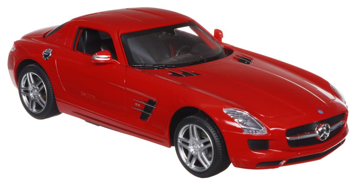"""Радиоуправляемая модель Rastar """"Mercedes-Benz SLS AMG"""" обязательно привлечет внимание взрослого и ребенка и понравится любому, кто увлекается автомобилями. Все дети хотят иметь в наборе своих игрушек ослепительные, невероятные и крутые автомобили на радиоуправлении. Тем более если это автомобиль известной марки с проработкой всех деталей, удивляющий приятным качеством и видом. Маневренная и реалистичная уменьшенная копия """"Mercedes-Benz SLS AMG"""" выполнена в точной детализации с настоящим автомобилем в масштабе 1:14. Управление машинкой происходит с помощью удобного пульта. Автомобиль двигается вперед и назад, поворачивает направо и налево. Автомобиль изготовлен из пластика с металлическими элементами. У модели открываются двери, при движении загораются фары. Колеса игрушки прорезинены и обеспечивают плавный ход, машинка не портит напольное покрытие. Радиоуправляемые игрушки способствуют развитию координации движений, моторики и ловкости. Ваш ребенок часами будет..."""