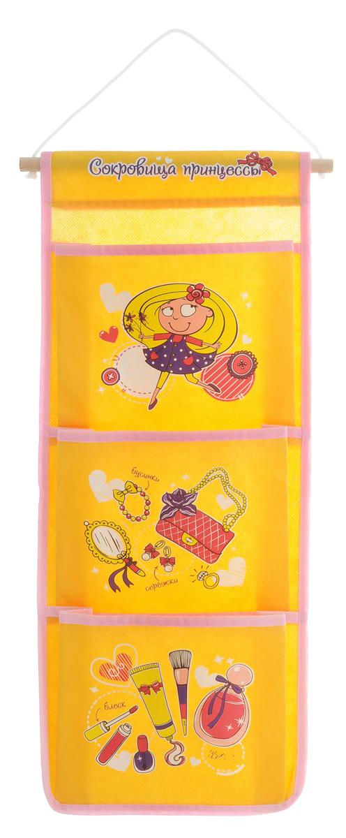 Кармашки на стену Sima-land Сокровища принцессы, цвет: желтый, 3 отделенияRG-D31SЯркие кармашки на стену Sima-land Сокровища принцессы с забавными рисунками и надписями, изготовленные из высококачественного текстиля, - очень полезная и удобная вещь в любом доме. Они предназначены для хранения необходимых вещей, множества мелочей в гардеробной, ванной, детской комнатах. Кармашки на стену компактные и вместительные, созданы для того, чтобы любимые вещички были всегда под рукой. Кармашки легко крепятся на стену и станут ее украшением.Размер кармашка: 17 х 13 см.