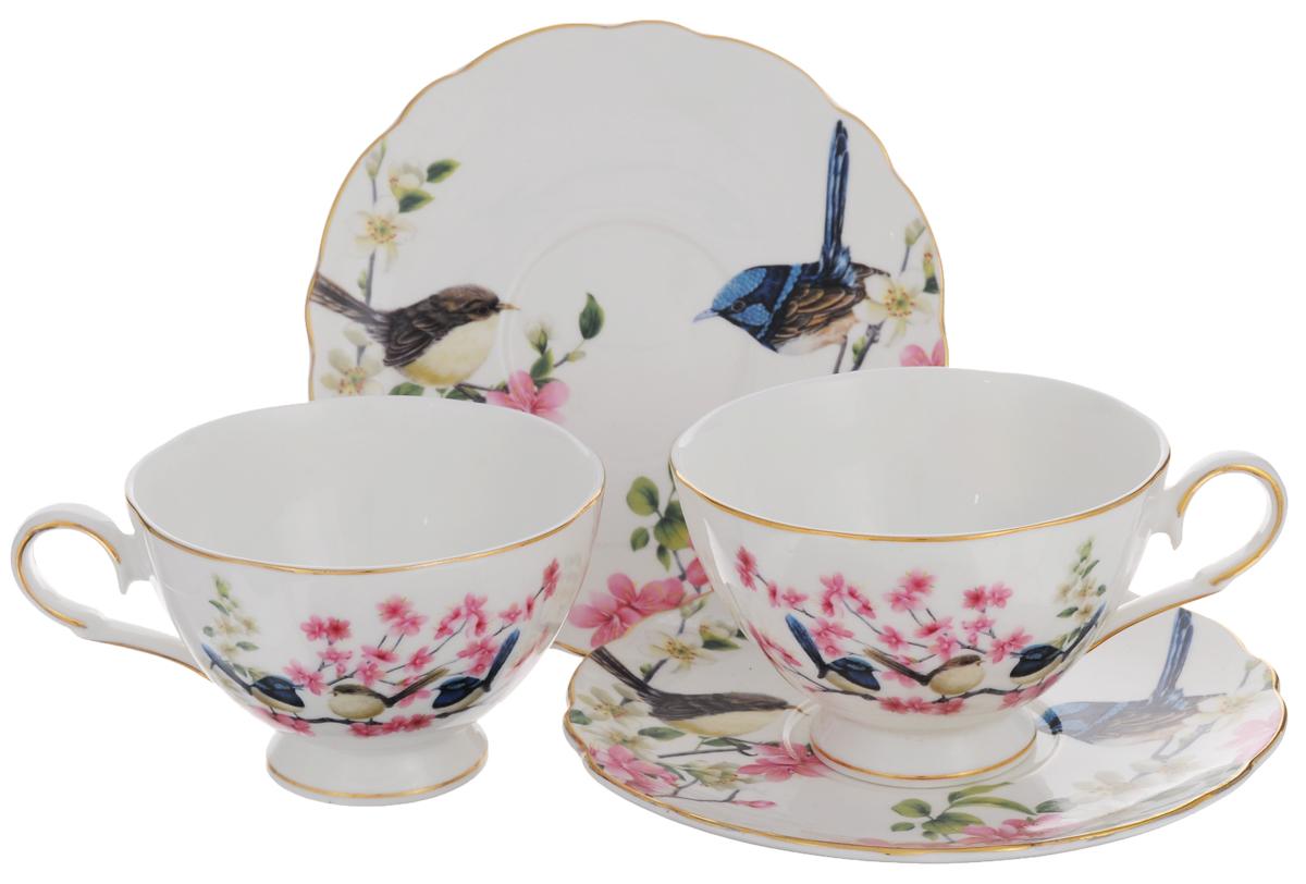 Набор чайный Elan Gallery Райские птички, 4 предметаVT-1520(SR)Набор чайный Elan Gallery Райские птички состоит из двух чашек и двух блюдец, выполненных из высококачественной керамики. Изделия оформлены изящным рисунком цветов и птиц. Изящный набор эффектно украсит стол к чаепитию и порадует вас функциональностью и ярким дизайном.Объем чашки: 220 мл.Диаметр чашки (по верхнему краю): 10 см.Высота чашки: 7 см.Диаметр блюдца: 15 см.