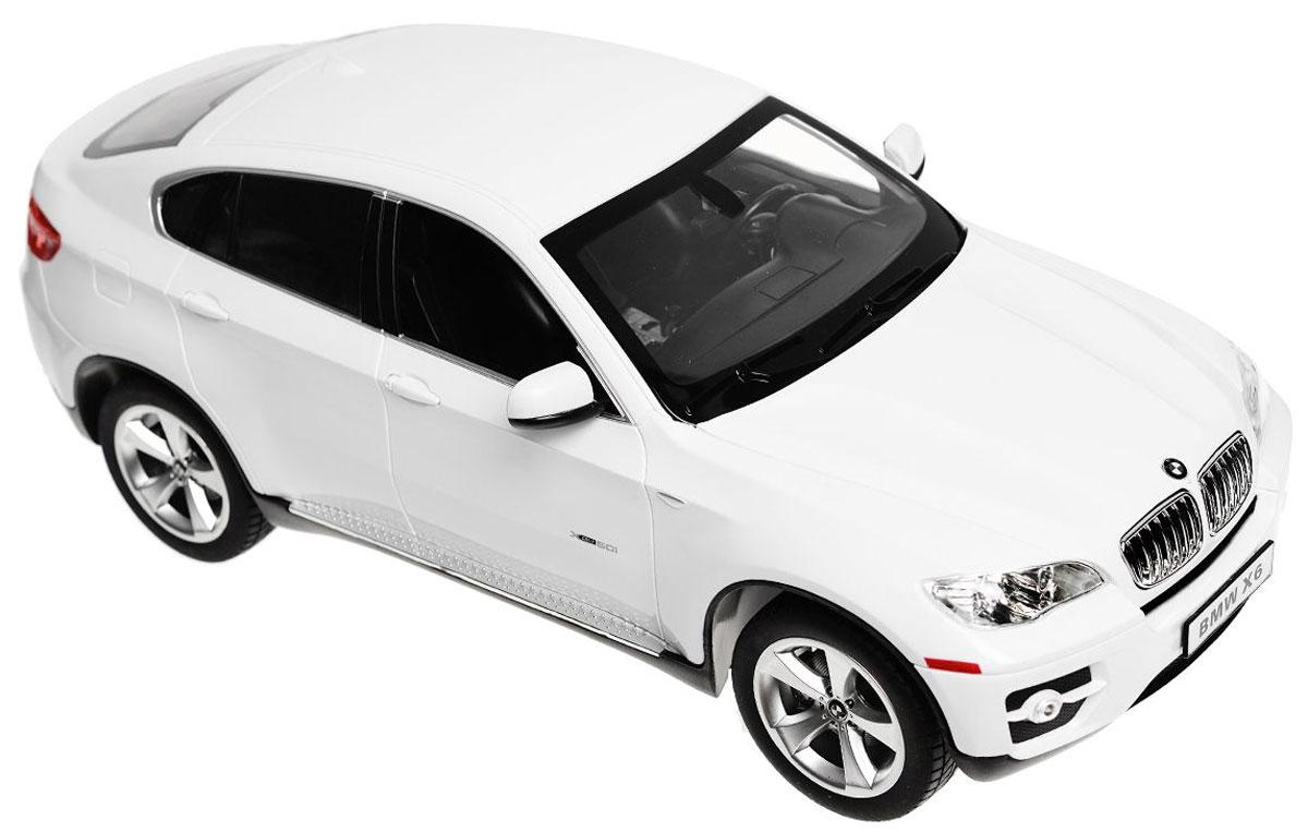 """Радиоуправляемая модель Rastar """"BMW X6"""" обязательно привлечет внимание взрослого и ребенка и понравится любому, кто увлекается автомобилями. Все дети хотят иметь в наборе своих игрушек ослепительные, невероятные и модные автомобили на радиоуправлении. Тем более, если это автомобиль известной марки с проработкой всех деталей, удивляющий приятным качеством и видом. Одной из таких моделей является автомобиль на радиоуправлении Rastar """"BMW X6"""". Это точная копия настоящего авто в масштабе 1:14. Авто обладает неповторимым провокационным стилем и спортивным характером. Потрясающая маневренность, динамика и покладистость - отличительные качества этой модели. Возможные движения: вперед, назад, вправо, влево, остановка. При движении загораются фары и стоп-сигналы. Машина работает от 5 батареек типа АА напряжением 1,5V, пульт работает от батарейки 9V типа """"Крона"""" (не входят в комплект)."""