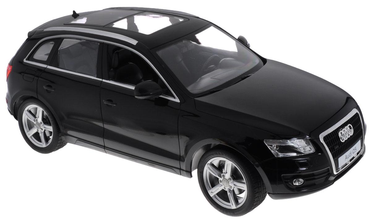 """Радиоуправляемая модель Rastar """"Audi Q5"""" обязательно привлечет внимание взрослого и ребенка и понравится любому, кто увлекается автомобилями. Маневренная и реалистичная уменьшенная копия """"Audi Q5"""" выполнена в точной детализации с настоящим автомобилем в масштабе 1:14. Управление машинкой происходит с помощью пульта. Машинка двигается вперед и назад, поворачивает направо, налево и останавливается. Оснащена световыми эффектами. Колеса игрушки прорезинены и обеспечивают плавный ход, машинка не портит напольное покрытие. Радиоуправляемые игрушки способствуют развитию координации движений, моторики и ловкости. Ваш ребенок часами будет играть с моделью, придумывая различные истории и устраивая соревнования. Порадуйте его таким замечательным подарком! Машина работает от 5 батареек напряжением 1,5V типа АА (не входят в комплект). Пульт управления работает от батарейки 9V типа """"Крона"""" (не входит в комплект)."""