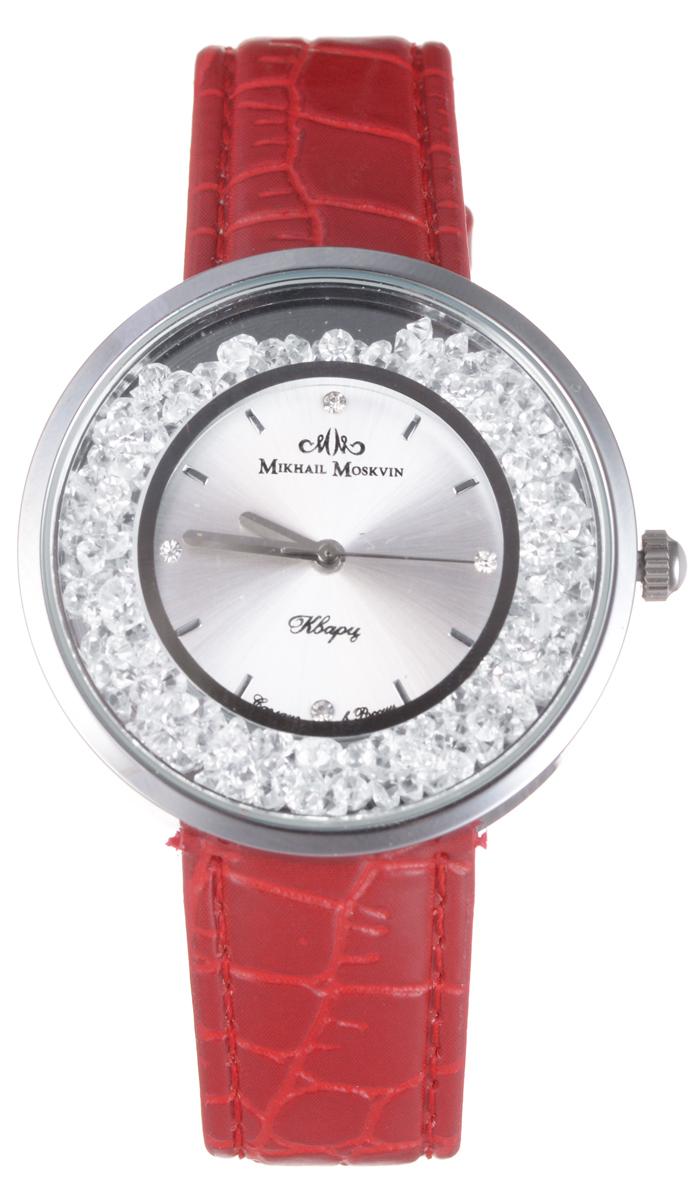 Часы женские наручные Mikhail Moskvin Каприз, цвет: серебряный, красный. 1146A1L1/3BM8434-58AEЭлегантные женские часы Mikhail Moskvin Каприз выполнены из нержавеющей стали, натуральной кожи и минерального стекла. Циферблат изделия оформлен стразами и символикой бренда.Корпус часов оснащен кварцевым механизмом, имеет степень влагозащиты равную 3 bar, а также дополнен устойчивым к царапинам минеральным стеклом. Ремешок часов украшен тиснением под рептилию,оснащен классической пряжкой, которая позволит с легкостью снимать и надевать изделие.Часы поставляются в фирменной упаковке.Часы Mikhail Moskvin Каприз подчеркнут изящность женской руки и отменное чувство стиля у их обладательницы.
