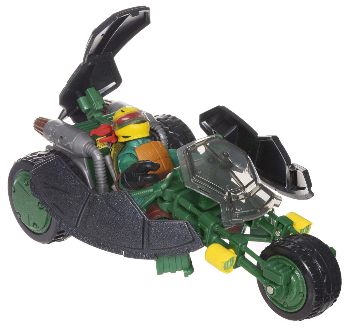 """Мотоцикл Черепашки Ниндзя """"Стелс"""" непременно понравится вашему ребенку и надолго займет его внимание. В комплект входит мотоцикл Черепашек-ниндзя """"Стелс"""" (""""Невидимка""""), фигурка в виде Рафаэля - персонажа команды """"TMNT"""" и 2 меча. Мотоцикл с тремя вращающимися колесами трансформируется из невидимого режима в боевой одним нажатием на панцирь. Фигурка имеет шарнирное устройство конечностей, что позволяет фиксировать ее в нужном положении. На мотоцикл можно посадить любого участника команды """"TMNT"""". Ваш ребенок с удовольствием будет играть с мотоциклом, придумывая различные истории. Порадуйте его таким замечательным подарком!"""