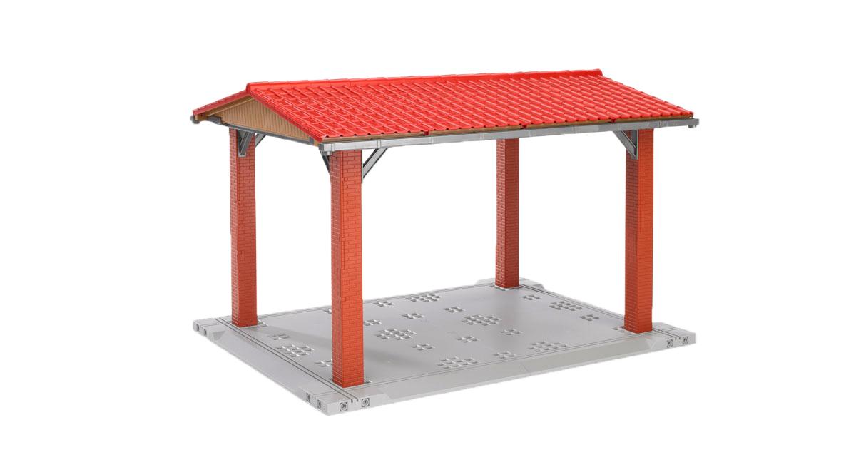 """Для любой машины необходима защита от осадков и солнца. Навес для транспорта """"Bruder"""" предназначен для строительной и сельской техники, которая не выше 24 сантиметров. Он изготовлен из пластиковых деталей, которые имитируют кирпичные опоры, металлические балки, жестяные системы слива, черепицу крыши и бетонное основание. Эта конструкция легко собирается, крышу можно снять. При желании навес можно соединять с другими формами. Навес предоставит вашему ребенку возможность придумывать различные сценарии игры, развивать воображение."""