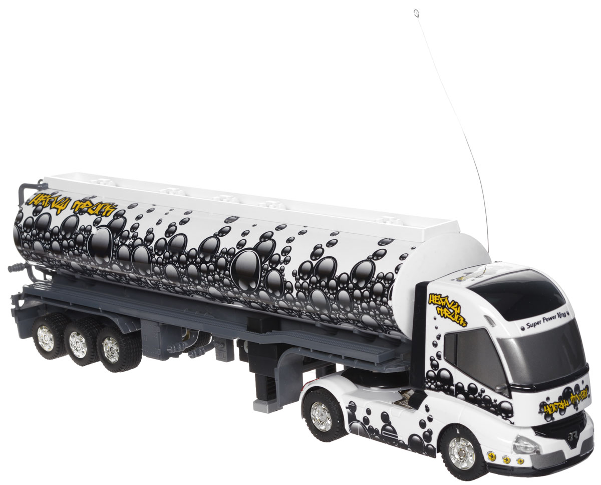 """Яркий грузовик-тягач на радиоуправлении 1TOY """"Драйв"""" - копирующий реальную технику. При включении грузовика раздается звук заводящегося двигателя, движение и парковка также сопровождаются соответствующими звуками ускорения, тормозов и работы парктроника. Кузов прикрепляется к кабине на магнитных присосках, которые отсоединяются и присоединяются с пульта управления. При движении грузовика загорается подсветка автоплатформы. Машина двигается вперед и назад, поворачивает направо, налево. Радиоуправляемые игрушки способствуют развитию координации движений, моторики и ловкости. Ваш ребенок часами будет играть с грузовиком, придумывая различные истории. Порадуйте его таким замечательным подарком! Машина работает от 4 батареек типа АА напряжением 1,5V (не входят в комплект), пульт работает от батарейки 9V типа """"Крона"""" (входит в комплект)."""
