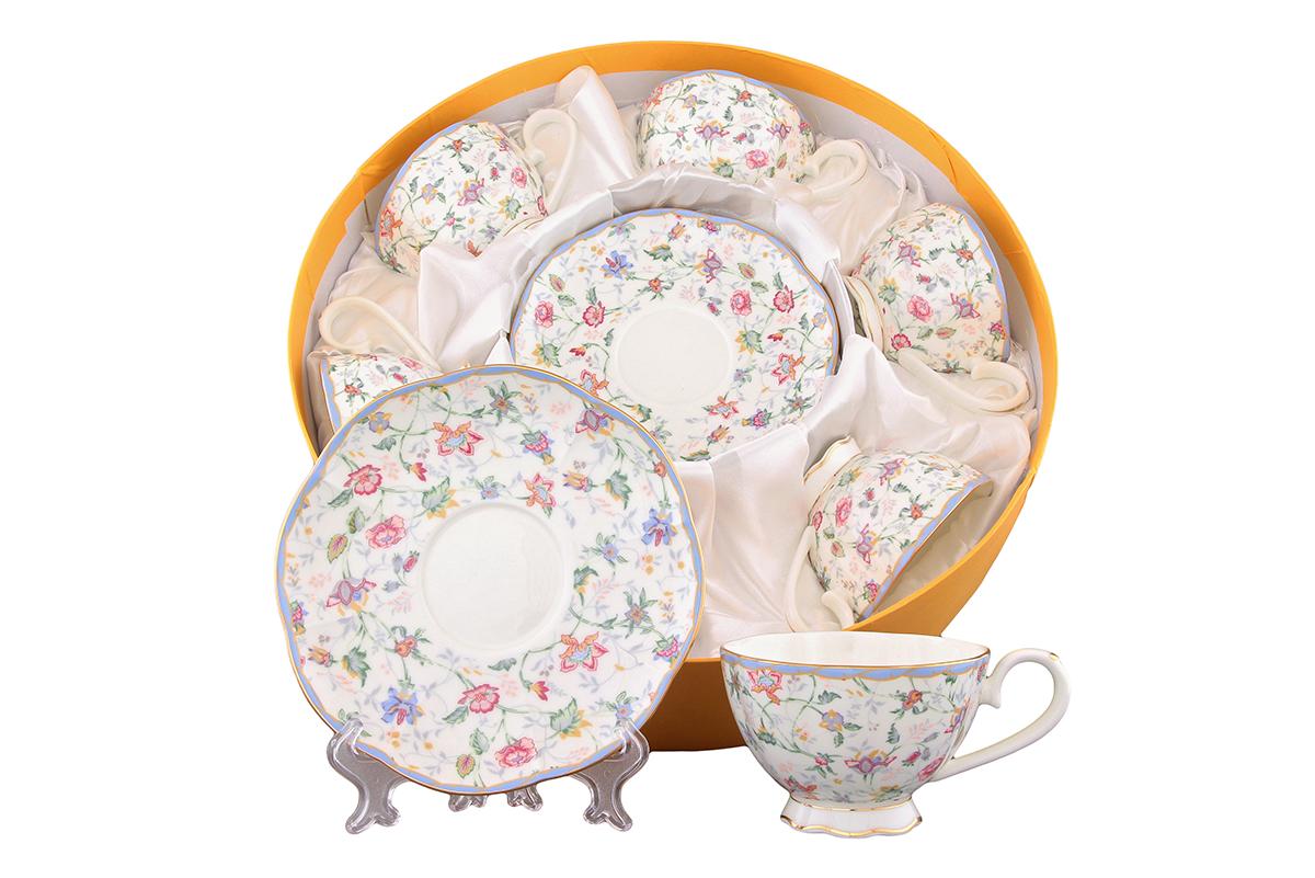Набор чайный Elan Gallery Цветочный каприз, 12 предметовVT-1520(SR)Чайный набор Elan Gallery Цветочный каприз состоит из 6 чашек и 6 блюдец. Изделия, выполненные из высококачественной керамики, имеют элегантный дизайн и классическую круглую форму.Такой набор прекрасно подойдет как для повседневного использования, так и дляпраздников. Чайный набор Elan Gallery Цветочный каприз - это не только яркий и полезный подарок для родных и близких, это также великолепное дизайнерское решение для вашей кухни или столовой. Не рекомендуется применять абразивные моющие средства.Не использовать в микроволновой печи.Объем чашки: 250 мл. Диаметр чашки (по верхнему краю): 10 см. Высота чашки: 6,5 см.Диаметр блюдца (по верхнему краю): 16 см.Высота блюдца: 2 см.