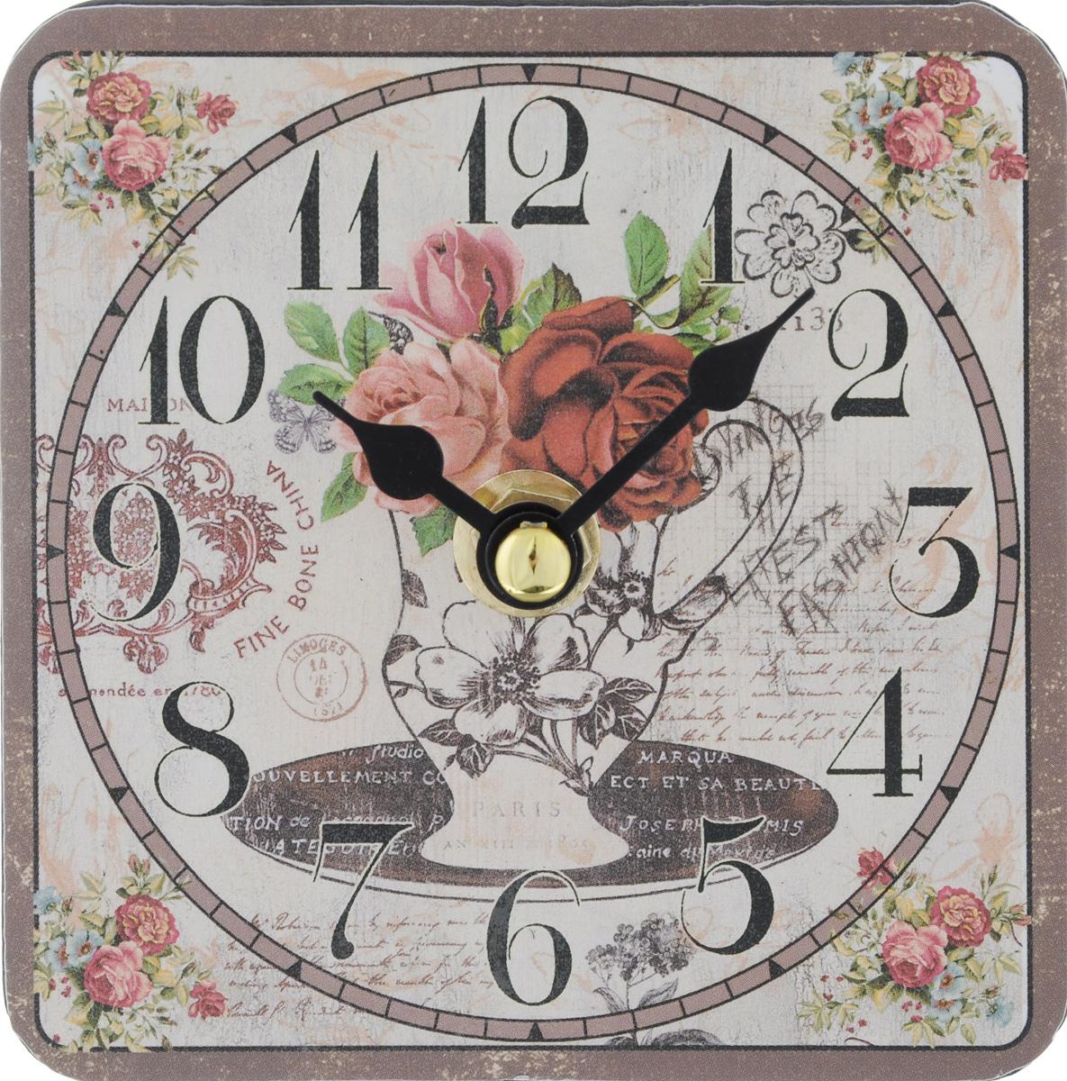 Часы настольные Феникс-Презент Ваза с цветами, 10 х 10 см94672Настольные часы квадратной формы Феникс-Презент Ваза с цветами своим эксклюзивным дизайном подчеркнут оригинальность интерьера вашего дома. Циферблат оформлен изображением вазы с цветами. Часы выполнены из МДФ. МДФ (мелкодисперсные фракции) представляет собой плиту из запрессованной вакуумным способом деревянной пыли и является наиболее экологически чистым материалом среди себе подобных. Часы имеют две стрелки - часовую и минутную.Настольные часы Феникс-Презент Ваза с цветами подходят для кухни, гостиной, прихожей или дачи, а также могут стать отличным подарком для друзей и близких.ВНИМАНИЕ!!! Часы работают от сменной батареи типа АА 1,5V (в комплект не входит).