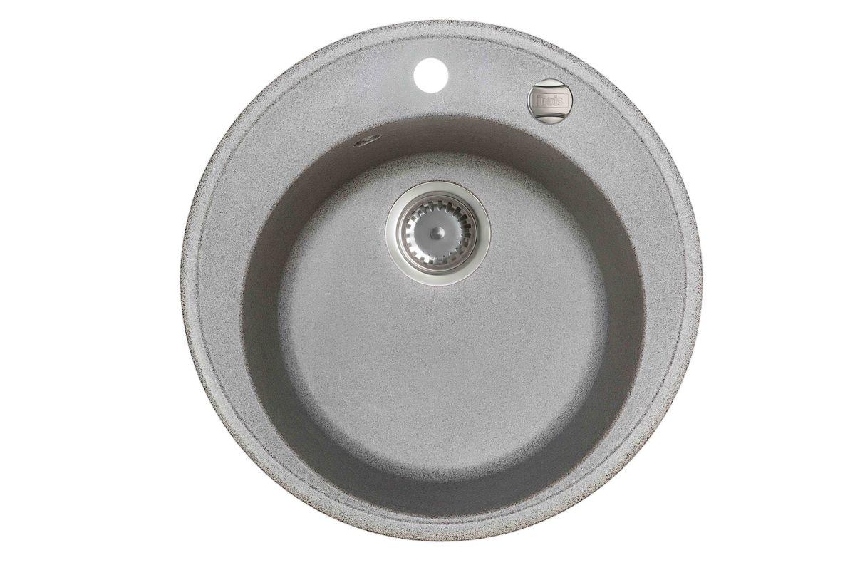 Мойка Iddis Kitchen G, Granucryl, цвет: серый, диаметр 51 см. K02G511i87BL505Мойки для кухни Iddis производятся из особого материала Granucryl: 80% натуральной гранитной крошки производства Германии, 20% акриловой смолы. Благодаря этому, он имеет высокую устойчивость к физическим и механическим воздействиям, стойкость к воздействию средств бытовой химии и перепадам температур во время эксплуатации - свойства, необходимые для комфортного и надежного использования мойки на современной кухне.Термостойкость. Granucryl выдерживает температуру до 280С, что позволяет хозяйкам ставить на мойку даже раскаленную посуду во время приготовления пищи. Стойкость цвета. Однородность материала Granucryl и высокотемпературная пигментация гранитной крошки обеспечивает первозданную яркость цвета мойки в течение всего периода эксплуатации. Пигментация происходит во вращающихсяпечах при температуре до 600 градусов. Каждая частица гранита химически связывается с пигментом, получая свой неповторимый цвет. При этом цвет никогда не выцветает и не может быть удален с поверхности мойки.Практичность.Мелкие царапины, образующиеся при использовании, не видны на мойках IDDIS благодаря однородной структуре и пигментации гранитной крошки материала Granucryl. Гигиеничность.Состав материала Granucryl препятствует размножению бактерий на поверхности моек, что гарантирует их безопасность в условиях повышенной влажности кухни. Гигиеничность материала Granucryl подтверждена немецким институтом гигиены.Мойки Granucryl имеют полный комплект для установки: шаблон для выреза отверстия в столешнице, крепления, автоматический выпуск с переливом и плоский сифон с возможностью подключения посудомоечной или стиральной машины. Наличие готовых отверстий под смеситель и кнопку донного клапана позволяет быстро и легко установить эти изделия на мойку.Мойки Granucryl, благодаря составу материала, а также толщине 10 мм, поглощают шум воды. Гарантия на мойки Granucryl торговой марки Iddis составляет 10 лет.Мойки Granucryl