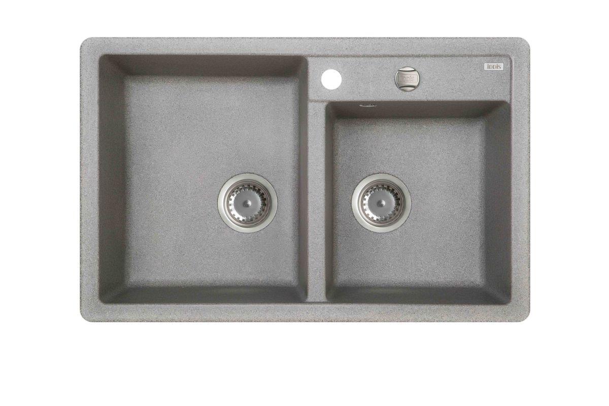 Мойка Iddis Vane G, Granucryl, 2 чаши, цвет: серый, 78 х 50 см. V22G782i87STR96PCi77Мойки для кухни Iddis производятся из особого материала Granucryl: 80% натуральной гранитной крошки производства Германии, 20% акриловой смолы. Благодаря этому, он имеет высокую устойчивость к физическим и механическим воздействиям, стойкость к воздействию средств бытовой химии и перепадам температур во время эксплуатации - свойства, необходимые для комфортного и надежного использования мойки на современной кухне.Термостойкость. Granucryl выдерживает температуру до 280С, что позволяет хозяйкам ставить на мойку даже раскаленную посуду во время приготовления пищи. Стойкость цвета. Однородность материала Granucryl и высокотемпературная пигментация гранитной крошки обеспечивает первозданную яркость цвета мойки в течение всего периода эксплуатации. Пигментация происходит во вращающихсяпечах при температуре до 600 градусов. Каждая частица гранита химически связывается с пигментом, получая свой неповторимый цвет. При этом цвет никогда не выцветает и не может быть удален с поверхности мойки.Практичность.Мелкие царапины, образующиеся при использовании, не видны на мойках IDDIS благодаря однородной структуре и пигментации гранитной крошки материала Granucryl. Гигиеничность.Состав материала Granucryl препятствует размножению бактерий на поверхности моек, что гарантирует их безопасность в условиях повышенной влажности кухни. Гигиеничность материала Granucryl подтверждена немецким институтом гигиены.Глубина чаши моек Granucryl составляет 210, размеры 360 х 430 и 320 х 350 мм.Мойки Granucryl имеют полный комплект для установки: шаблон для выреза отверстия в столешнице, крепления, автоматический выпуск с переливом и плоский сифон с возможностью подключения посудомоечной или стиральной машины. Наличие готовых отверстий под смеситель и кнопку донного клапана позволяет быстро и легко установить эти изделия на мойку.Мойки Granucryl, благодаря составу материала, а также толщине 10 мм, поглощают шум воды