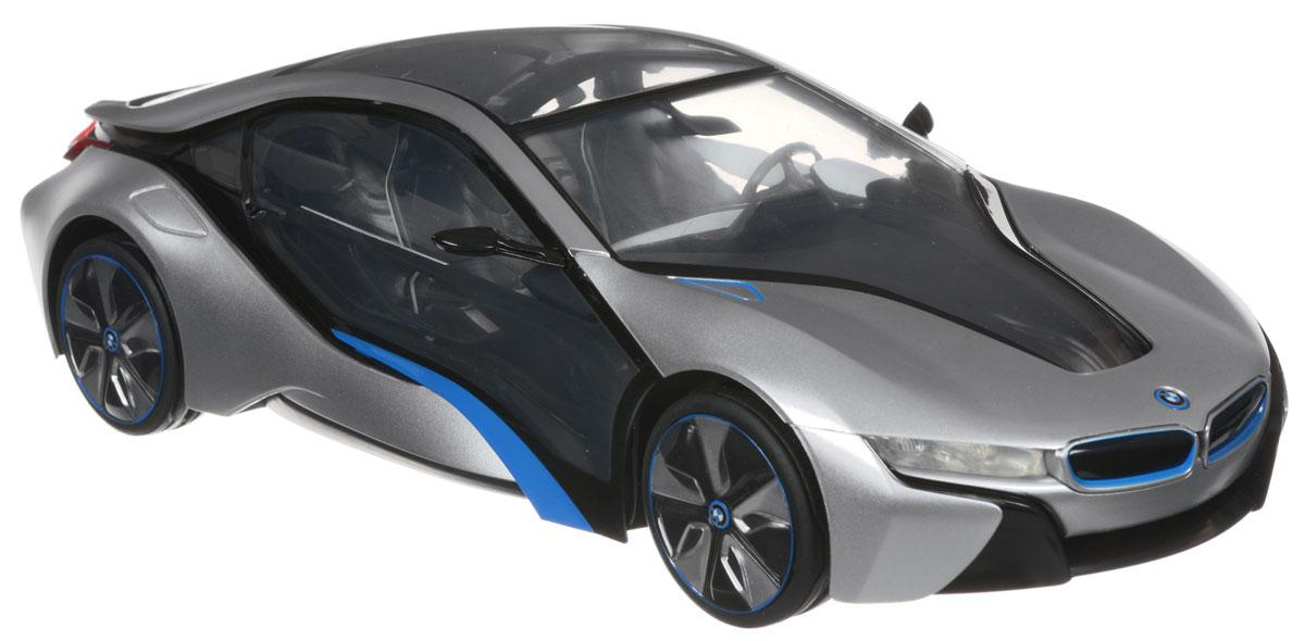 """Радиоуправляемая модель Rastar """"BMW I8"""" станет отличным подарком любому мальчику! Все дети хотят иметь в наборе своих игрушек ослепительные, невероятные и крутые автомобили на радиоуправлении. Тем более, если это автомобиль известной марки с проработкой всех деталей, удивляющий приятным качеством и видом. Одной из таких моделей является автомобиль на радиоуправлении Rastar """"BMW I8"""". Это точная копия настоящего авто в масштабе 1:14. Авто обладает неповторимым провокационным стилем и спортивным характером. Потрясающая маневренность, динамика и покладистость - отличительные качества этой модели. Возможные движения: вперед, назад, вправо, влево, остановка. Имеются световые эффекты. Аккуратно нажмите на заднюю часть кузова автомобиля для включения и отключения передних или задних фар, а также подсветки салона. Пульт управления работает на частоте 40 MHz. Для работы машины необходимы 5 батареек типа АА (не входят в комплект). Для работы..."""