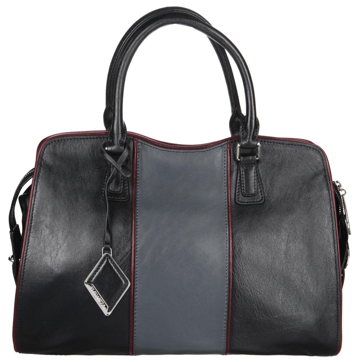 Сумка женская Eleganzza, цвет: черный. Z29-5166L39845800Стильная сумка Eleganzza, изготовлена из натуральной кожи, оформлена металлической фурнитурой и подвеской ромбовидной формы.Изделие содержит одно отделение, которое закрывается на застежку-молнию. Внутри изделия расположены два накладных кармашка для мелочей, врезной карман на молнии. Задняя сторона сумки дополнена врезным карманом на молнии. Изделие оснащено двумя практичными ручками и съемным плечевым ремнем. Дно сумки дополнено металлическими ножками, которые защитят изделие от преждевременного изнашивания.Оригинальный аксессуар позволит вам завершить образ и быть неотразимой.