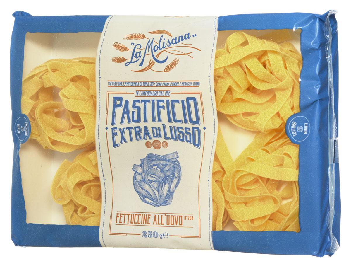 La Molisana Fettuccine яичная лапша в гнездах макаронные изделия 250 г0120710Яичная лапша La Molisana Fettuccine изготовлена из муки твердых сортов пшеницы, содержащей чуть меньшее количество клейковины, чем обыкновенная мука. Она хорошо поглощает воду, макароны из нее при варке не развариваются. Вы сможете приготовить великолепные гнезда с соусом по вашему вкусу, или другой гарнир - эти макароны безусловно подойдут для любого блюда!