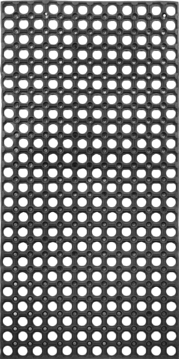 Коврик придверный SunStep, грязесборный, 100 х 50 смTHN132NПридверный коврик SunStep изготовлен из прочной и долговечной резины. Конструкция коврика имеет специальные ребра, которые помогают более эффективно удалять грязь с обуви, а отверстия в конструкции удаляют излишки воды. Придверный коврик SunStep надежно защитит помещение от уличной пыли и грязи.