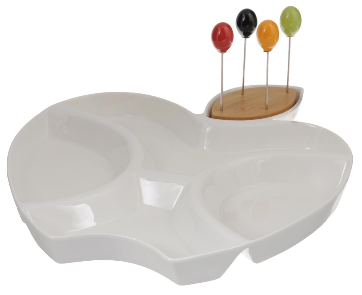 Менажница Elan Gallery Яблоко, со шпажками, 4 секции115510Менажница Elan Gallery Яблоко изготовлена из керамики и предназначена для подачи сразу нескольких видов закусок, нарезок или соусов. В комплект также входят 4 разноцветные шпажки, которые вставляются в деревянную подставку.Менажница Elan Gallery Яблоко станет настоящим украшением праздничного стола и подчеркнет ваш изысканный вкус. Не использовать в микроволновой печи.Общий размер менажницы: 31,5 х 28 х 3 см.Средний размер секций: 15,5 х 10 х 3 см.Длина шпажки: 9,2 см.