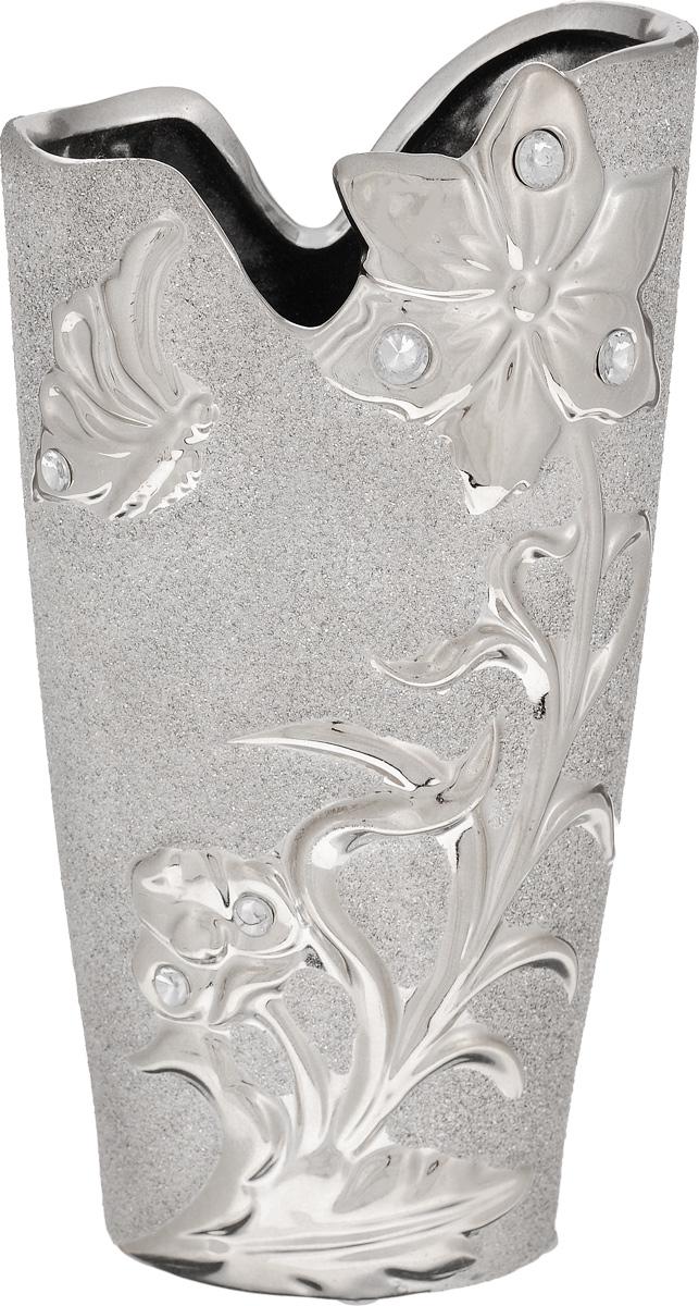 Ваза Sima-land Летнее настроение, высота 25,4 смFS-91909Ваза Sima-land Летнее настроение, изготовленная из высококачественной керамики, оформлена объемнымиизображениями и декорирована стразами и блестками. Дно изделия оснащено нескользящими накладками. Интересная форма и необычное оформление сделают эту вазу замечательным украшением интерьера. Она предназначенакак для живых, так и для искусственных цветов. Любое помещение выглядит незавершенным без правильно расположенных предметов интерьера. Они помогают создать уют, расставить акценты, подчеркнуть достоинства или скрыть недостатки.