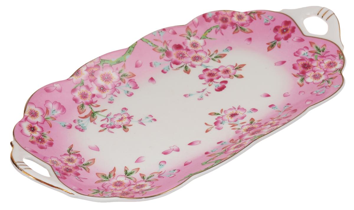 Блюдо для нарезки Elan Gallery Сакура, 30 х 15 см115510Блюдо для нарезки Elan Gallery Сакура, изготовленное из керамики, прекрасно подойдет для подачи нарезок, закусок и других блюд. Блюдо дополнено двумя удобными ручками и оформлено цветочным рисунком. Такое блюдо украсит сервировку вашего стола и подчеркнет прекрасный вкус хозяйки. Не рекомендуется применять абразивные моющие средства. Не использовать в микроволновой печи.Размер блюда по верхнему краю (с учетом ручек): 30 х 15 см.