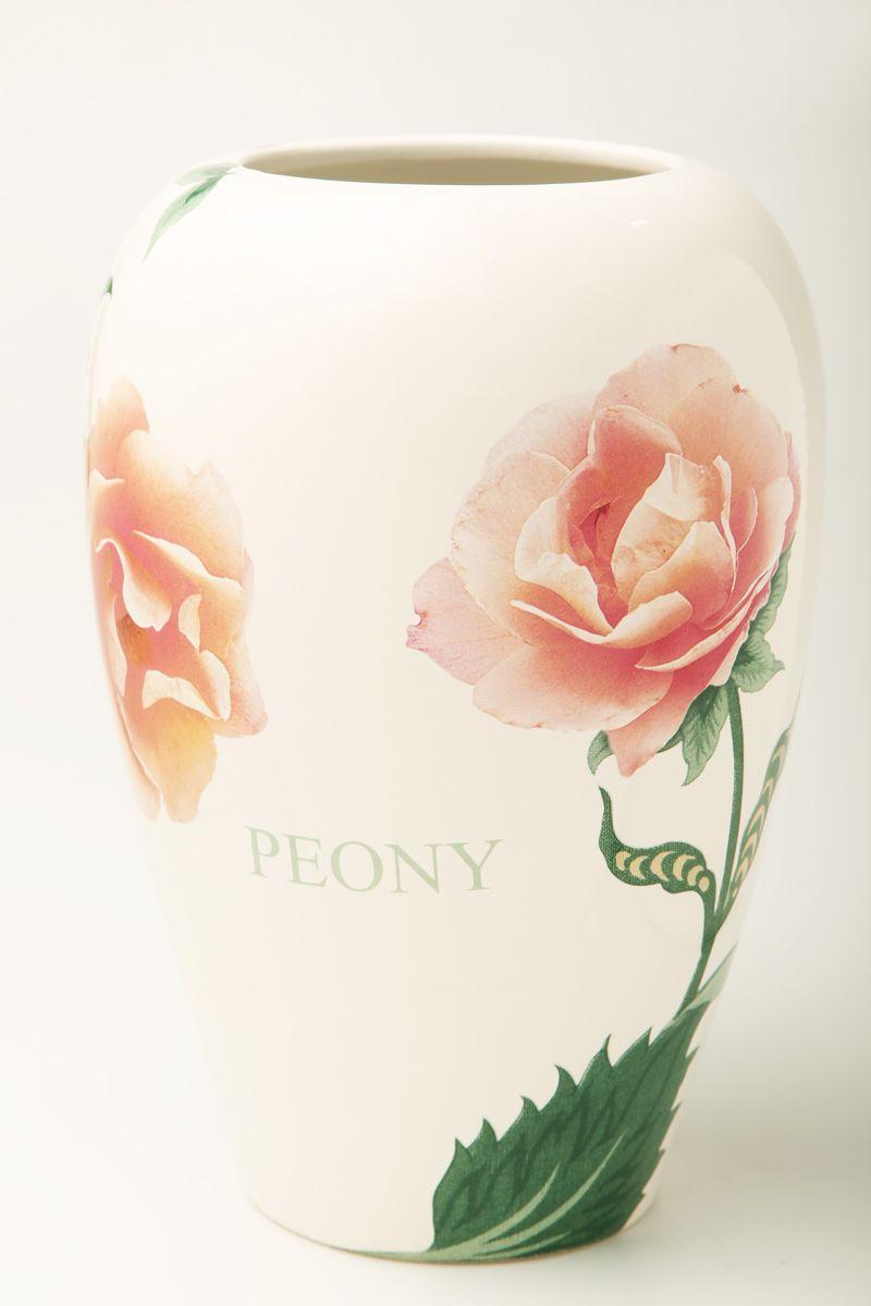 Ваза Nuova R2S Пионы, высота 26 см106831Изящная ваза Nuova R2S Пионы изготовлена из керамики и оформлена цветочным рисунком. Изделие сочетает в себе оригинальный дизайн с максимальной функциональностью.Ваза Nuova R2S Пионы дополнит интерьер офиса или дома и станет желанным подарком для ваших близких.Диаметр вазы: 19 см.Высота вазы: 26 см.