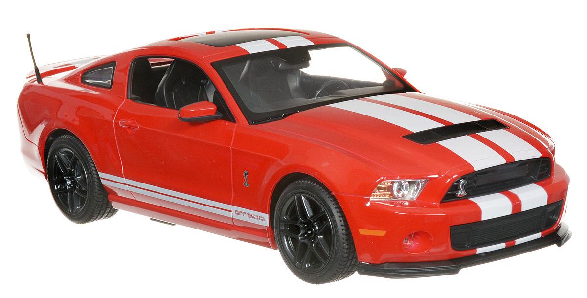 """Радиоуправляемая модель Rastar """"Ford Shelby GT500"""" предназначена для тех, кто любит роскошь и высокие скорости. Маневренная и реалистичная уменьшенная копия Ford Shelby GT500 выполнена в точной детализации с настоящим автомобилем в масштабе 1:14. Управление машиной происходит с помощью пульта. Машина двигается вперед и назад, поворачивает направо, налево и останавливается. Имеются световые эффекты. Колеса игрушки прорезинены и обеспечивают плавный ход, машина не портит напольное покрытие. Радиоуправляемые игрушки способствуют развитию координации движений, моторики и ловкости. Ваш ребенок часами будет играть с моделью, придумывая различные истории и устраивая соревнования. Порадуйте его таким замечательным подарком! Машина работает от 5 батареек напряжением 1,5V типа АА (не входят в комплект). Пульт управления работает от батарейки 9V типа """"Крона"""" (не входит в комплект)."""