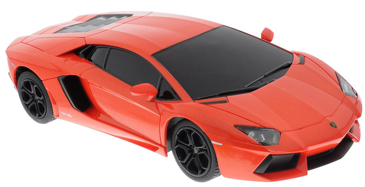 """Радиоуправляемая модель Rastar """"Lamborghini Aventador LP 700-4"""" предназначена для тех, кто любит роскошь и высокие скорости. Это авто обладает неповторимым провокационным стилем и спортивным характером. Маневренная и реалистичная копия реального авто выполнена с точной детализации в масштабе 1:24. Управление машинкой происходит с помощью пульта. Машинка двигается вперед и назад, поворачивает направо и налево. Пульт управления работает на частоте 40 MHz. Колеса игрушки прорезинены и обеспечивают плавный ход, машинка не портит напольное покрытие. Радиоуправляемые игрушки способствуют развитию координации движений, моторики и ловкости. Ваш ребенок часами будет играть с моделью, придумывая различные истории и устраивая соревнования. Порадуйте его таким замечательным подарком! Машина работает от 3 батареек напряжением 1,5V типа АА (не входят в комплект). Пульт управления работает от 2 батареек напряжением 1,5V типа АА (не входят в комплект)."""