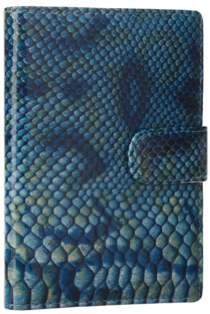 Обложка для документов женская Leo Ventoni, цвет: синий, голубой, зеленый. L330294490300нСтильная обложка для автодокументов Leo Ventoni выполнена из натуральной лаковой кожи с принтом и тиснением под рептилию. Подкладка из полиэстера. Изделие раскладывается пополам и закрывается хлястиком на магнитную кнопку. Внутри размещены вкладыш на металлической спирали из прозрачного мягкого пластика с пятью файлами для автодокументов, шесть кармашков для кредитных карт, карман с прозрачным пластиковым окошком, два боковых кармана для вкладыша или паспорта и один боковой карман для мелочей. Изделие поставляется в фирменной упаковке. Оригинальная обложка для автодокументов Leo Ventoni станет отличным подарком для человека, ценящего качественные и практичные вещи.