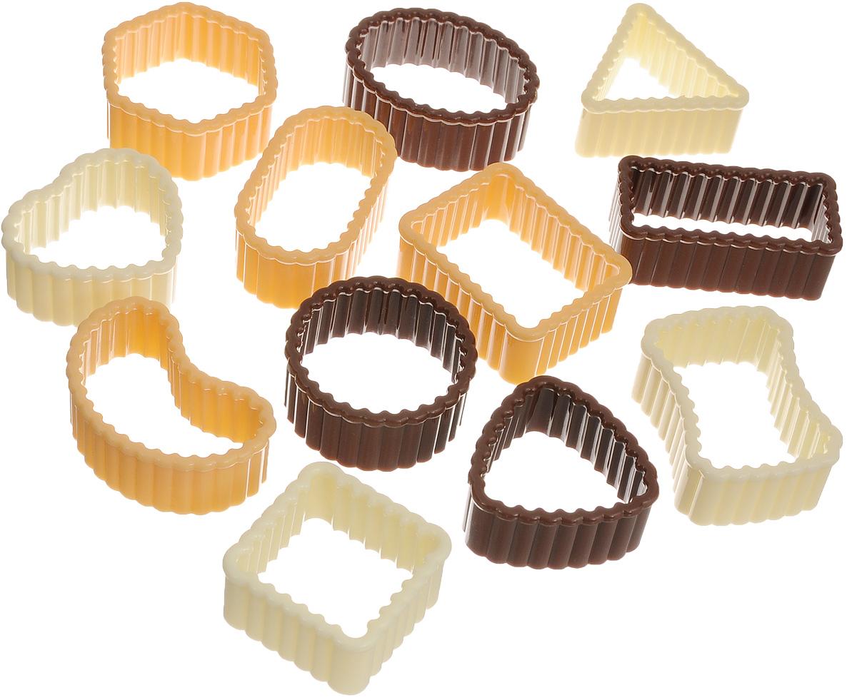 Формочки для печенья Tescoma Delicia, 12 штук94672Формочки для печенья Tescoma Delicia изготовлены из пластика. Предназначены для вырезания печенья. Можно использовать как трафареты для поделок и с непищевыми материалами. С такими формами-резаками можно сделать множество интересных фигурок и поделок. В набор входит пластиковое кольцо для удобного хранения формочек. Средний размер форм: 3,5 х 4 см. Высота стенки формы: 2 см. Диаметр кольца: 9,5 см.