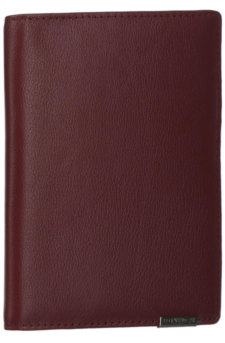 Обложка для документов женская Leo Ventoni, цвет: красно-коричневый. L330959W16-11135_914Стильная обложка для документов Leo Ventoni выполнена из натуральной кожи с зернистой поверхностью и дополнена металлической пластиной с символикой бренда.Подкладка из полиэстера. Внутри размещены два боковых кармана для паспорта, пять кармашков для кредитных карт или визиток, один боковой карман для мелочей и карман с прозрачным пластиковым окошком.Изделие поставляется в фирменной упаковке.Оригинальная обложка для документов Leo Ventoni станет отличным подарком для человека, ценящего качественные и практичные вещи.