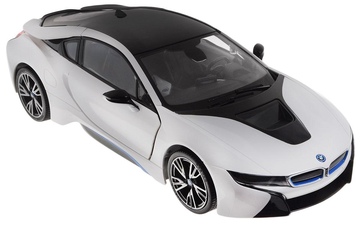 """Радиоуправляемая модель Rastar """"BMW i8"""" станет отличным подарком любому мальчику! Все дети хотят иметь в наборе своих игрушек ослепительные, невероятные и крутые автомобили на радиоуправлении. Тем более, если это автомобиль известной марки с проработкой всех деталей, удивляющий приятным качеством и видом. Одной из таких моделей является автомобиль на радиоуправлении Rastar """"BMW I8"""". Это точная копия настоящего авто в масштабе 1:14. Авто обладает неповторимым провокационным стилем и спортивным характером. Потрясающая маневренность, динамика и покладистость - отличительные качества этой модели. Корпус автомобиля выполнен из металла с использованием пластиковых элементов. Возможные движения: вперед, назад, вправо, влево, остановка. Колеса игрушки прорезинены и обеспечивают плавный ход, машинка не портит напольное покрытие. Имеются световые эффекты, а также открывание дверей происходит дистанционно с пульта управления. Пульт управления работает на..."""