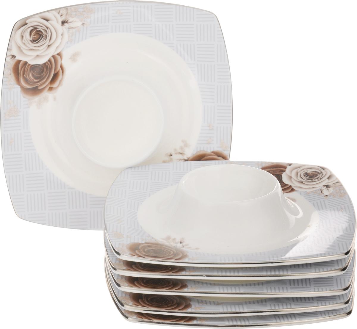Набор подставок под яйцо Family & Friends Дэниш, 12 х 12 см, 6 штPR8003нНабор Family & Friends Дэниш, выполненный из фарфора, состоит из 6 квадратных подставок, предназначенных для красивой подачи яиц. Изделия украшены цветочным рисунком. Набор сочетает в себе стильный дизайн с максимальнойфункциональностью. Оригинальность оформления придется по вкусу и ценителям классики, и тем, кто предпочитаетутонченность и изящность.Диаметр отверстия для яйца: 4,5 см. Размер подставки: 12 х 12 х 1,5 см.