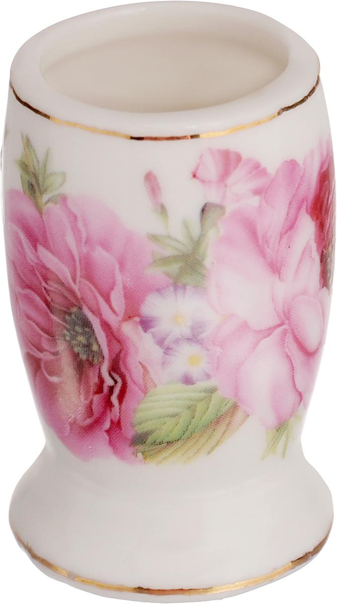 Вазочка под зубочистки Elan Gallery Розовые розы, высота 5 см115610Изящная вазочка под зубочистки Elan Gallery Розовые розы, выполненная из высококачественнойкерамики, декорирована цветочным рисунком. Такая вазочка украсит ваш стол и подойдет вкачестве подарка для близких людей. Диаметр вазочки (по верхнему краю): 2,5 см.Высота: 5 см.