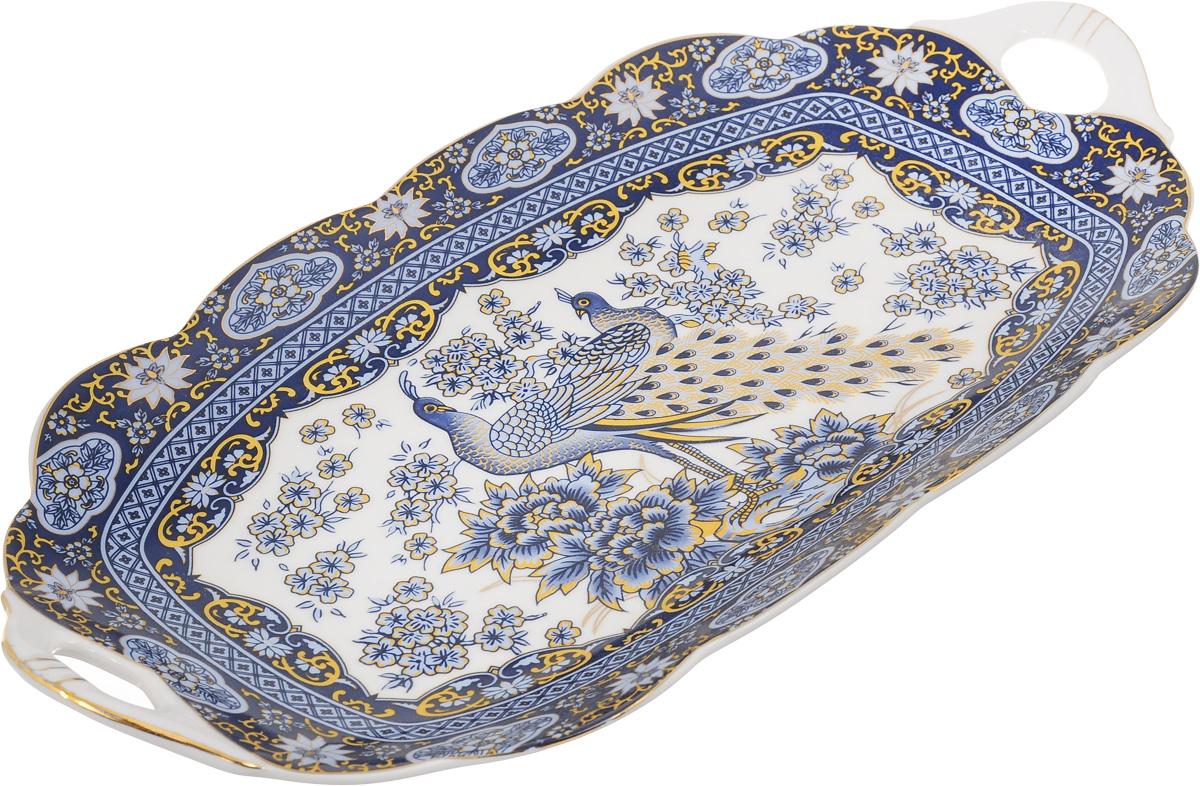 Блюдо для нарезки Elan Gallery Павлин, 30 х 15 смVT-1520(SR)Блюдо для нарезки Elan Gallery Павлин, изготовленное из керамики, прекрасно подойдет для подачи нарезок, закусок и других блюд. Блюдо дополнено двумя удобными ручками и оформлено рисунком. Такое блюдо украсит сервировку вашего стола и подчеркнет прекрасный вкус хозяйки. Не рекомендуется применять абразивные моющие средства. Не использовать в микроволновой печи.Размер блюда по верхнему краю (с учетом ручек): 30 х 15 см.