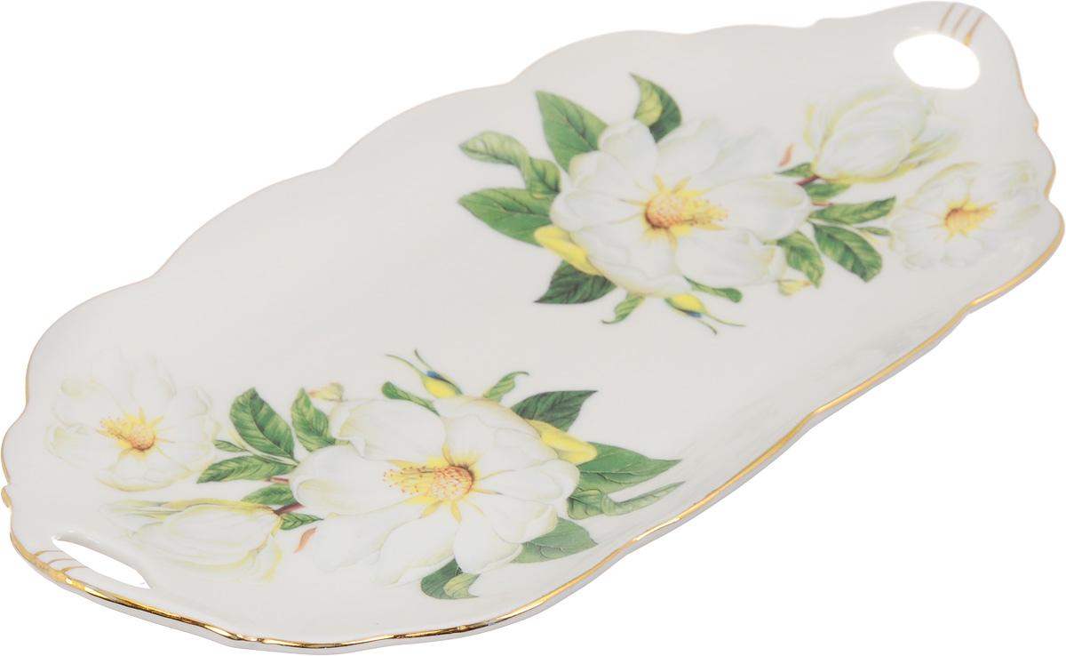 Блюдо для нарезки Elan Gallery Белый шиповник, 30 х 15 см740161Блюдо для нарезки Elan Gallery Белый шиповник, изготовленное из керамики, прекрасно подойдет для подачи нарезок, закусок и других блюд. Блюдо дополнено двумя удобными ручками и оформлено цветочным рисунком. Такое блюдо украсит сервировку вашего стола и подчеркнет прекрасный вкус хозяйки. Не рекомендуется применять абразивные моющие средства. Не использовать в микроволновой печи.Размер блюда по верхнему краю (с учетом ручек): 30 х 15 см.