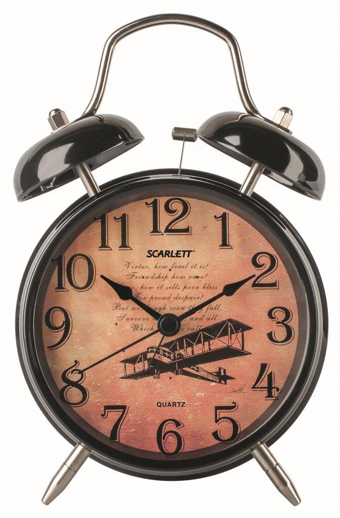 Будильник Scarlett. SC - AC1009BFA-2421-4 BlackБудильник Scarlett с надежным кварцевым механизмом - это не только функциональное устройство, но и оригинальный элемент декора, который великолепно впишется в интерьер вашего дома. Он снабжен четырьмя стрелками: часовой, минутной, секундной и стрелкой завода. Циферблат оформлен в классическом стиле. Сверху будильника располагается механический звонок, работает до его отключения. Отличительной особенностью этого будильника является то, что он обладает плавным, бесшумным ходом. Будильник работает от 1 батарейки типа АА напряжением 1,5 В (батарейка в комплект не входит). Будильник Scarlett - это надежность, качество и изящность стиля во все времена.