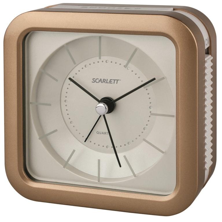 Будильник Scarlett, с подсветкой, цвет: коричневый, 9,4 х 9,4 смFA-2421-2 WhiteБудильник Scarlett с надежным кварцевым механизмом - это не только функциональное устройство, но и оригинальный элемент декора, который великолепно впишется в интерьер вашего дома. Он снабжен четырьмя стрелками: часовой, минутной, секундной и стрелкой завода. Циферблат оформлен в классическом стиле. Подсветка циферблата позволяет пользоваться будильником и в ночное время.Сигнал будильника электронный с функцией повтора сигнала, работает до его отключения. Отличительной особенностью этого будильника является то, что он обладает плавным, бесшумным ходом. Будильник работает от 1 батарейки типа АА напряжением 1,5 В (батарейка в комплект не входит). Будильник Scarlett - это надежность, качество и изящность стиля во все времена.