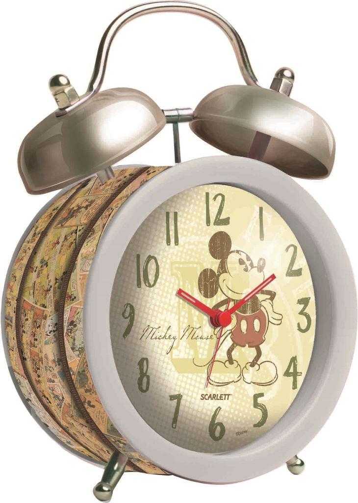 """Будильник """"Scarlett"""" с надежным кварцевым механизмом - это не только функциональное устройство, но и оригинальный элемент декора, который великолепно впишется в интерьер детской комнаты. Он снабжен четырьмя стрелками: часовой, минутной, секундной и стрелкой завода. Циферблат оформлен изображением Микки Мауса. Сверху будильника располагается механический звонок, работает до его отключения. Отличительной особенностью этого будильника является то, что он обладает плавным, бесшумным ходом. Будильник работает от 1 батарейки типа АА напряжением 1,5 В (батарейка в комплект не входит). Будильник """"Scarlett"""" - это надежность, качество и изящность стиля во все времена."""