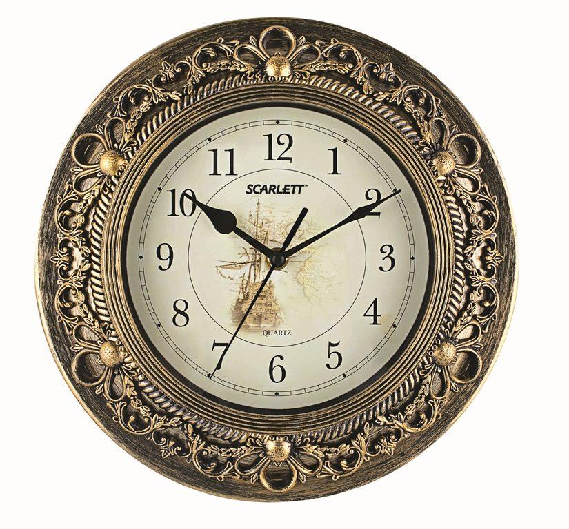 Часы настенные Scarlett, диаметр 30,5 см. SC - 27CП1-962/7-8Настенные кварцевые часы Scarlett в классическом дизайне, изготовленные из пластика, прекрасно впишутся в интерьер вашего дома. Круглые часы имеют три стрелки: часовую, минутную и секундную, циферблат защищен прозрачным пластиком. Часы работают от 1 батарейки типа АА напряжением 1,5 В (батарейка в комплект не входит). Диаметр часов: 30,5 см.