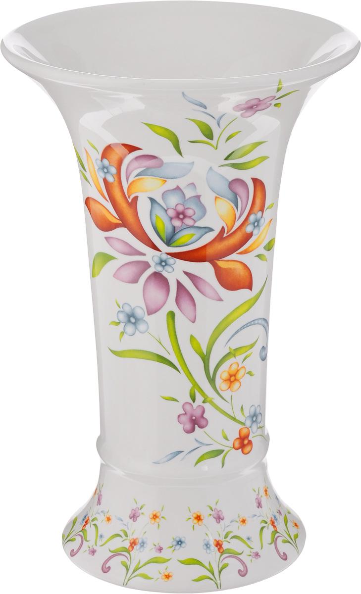 Ваза для цветов Imari Аквитания, высота 21,5 см332603Элегантная ваза Imari Аквитания выполнена из высококачественной керамики и оформлена ярким цветочным узором. Она придется по вкусу и ценителям классики, и тем, кто предпочитает утонченность и изящность. Вы можете поставить вазу в любом месте, где она будет удачно смотреться, и радовать глаз. Такая ваза подойдет и для цветов, и для декора интерьера. Кроме того - это отличный вариант подарка для ваших близких и друзей.Высота вазы: 21,5 см.Диаметр вазы по верхнему краю: 14 см.Диаметр основания вазы: 10 см.