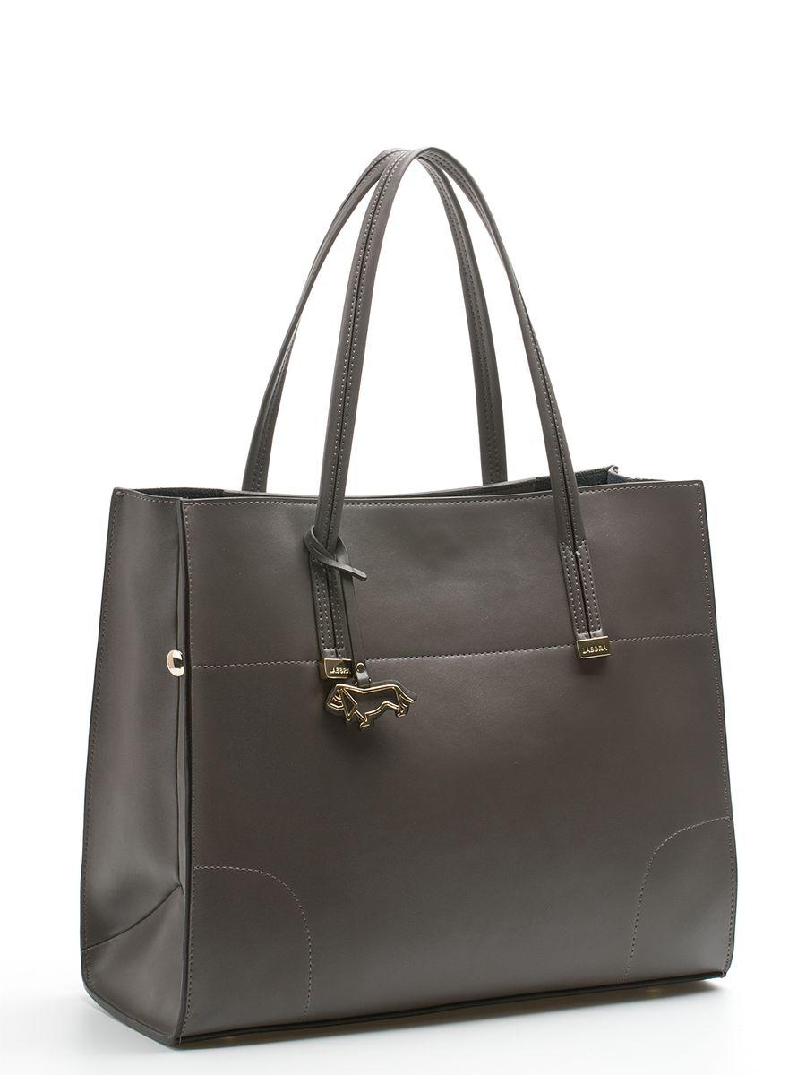 Сумка женская Labbra, цвет: серый. L-DA80616-2S76245Стильная женская сумка Labbra выполнена из натуральной кожи,дополнена золотистой фурнитурой и подвеской в виде символики бренда. Изделие имеет два вместительных отделения, одно из которых съемное (крепится к сумке с помощью кнопок). Съемное отделение выполнено из полиэстера и натуральной кожи, оформлено звериным принтом и может использоваться в качестве самостоятельной сумочки-косметички. Оно закрывается на застежку-молнию, внутри имеется прорезной карман на молнии, а снаружи два открытых пришивных кармана для телефона и мелочей. Роскошная сумка внесет элегантные нотки в ваш образ и подчеркнет ваше отменное чувство стиля. Лаконичный цвет и простая форма помогут ей вписаться даже в самый сложный и продуманный гардероб.