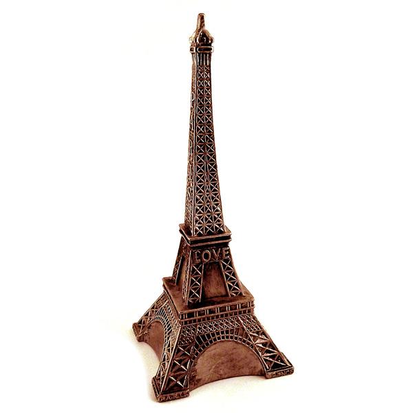 Копилка Эврика Эйфелева башня, высота 28 см663726Копилка Эврика Эйфелева башня, изготовленная из высококачественной термопластической резины, станет отличным украшением интерьера вашего дома или офиса. Изюминка данного изделия в том, что статую можно частично согнуть, сделав ее более забавной, тем самым намекнув, что не только Пизанская башня может быть наклонной.